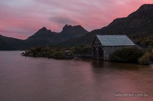 Sunset over the iconic boat shed on Dove Lake at Cradle Mountain