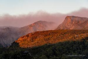 Sunrise hits the cliffs of Crater Peak