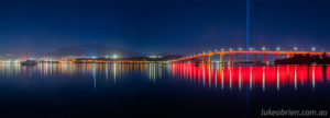 Panorama with the Hobart city lights and Mt Wellington skyline and Spectra rising above the red bridge