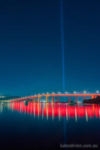Dark Mofo - Paint the Town Red. The Tasman Bridge in red and Spectra