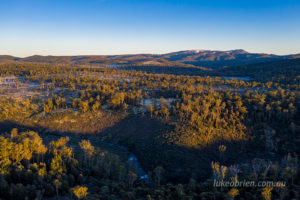 Black Bluff and the Iris river as the sun climbs higher into the cold winter sky