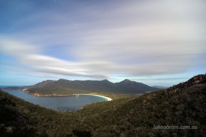 Star trails and clouds over Wineglass Bay